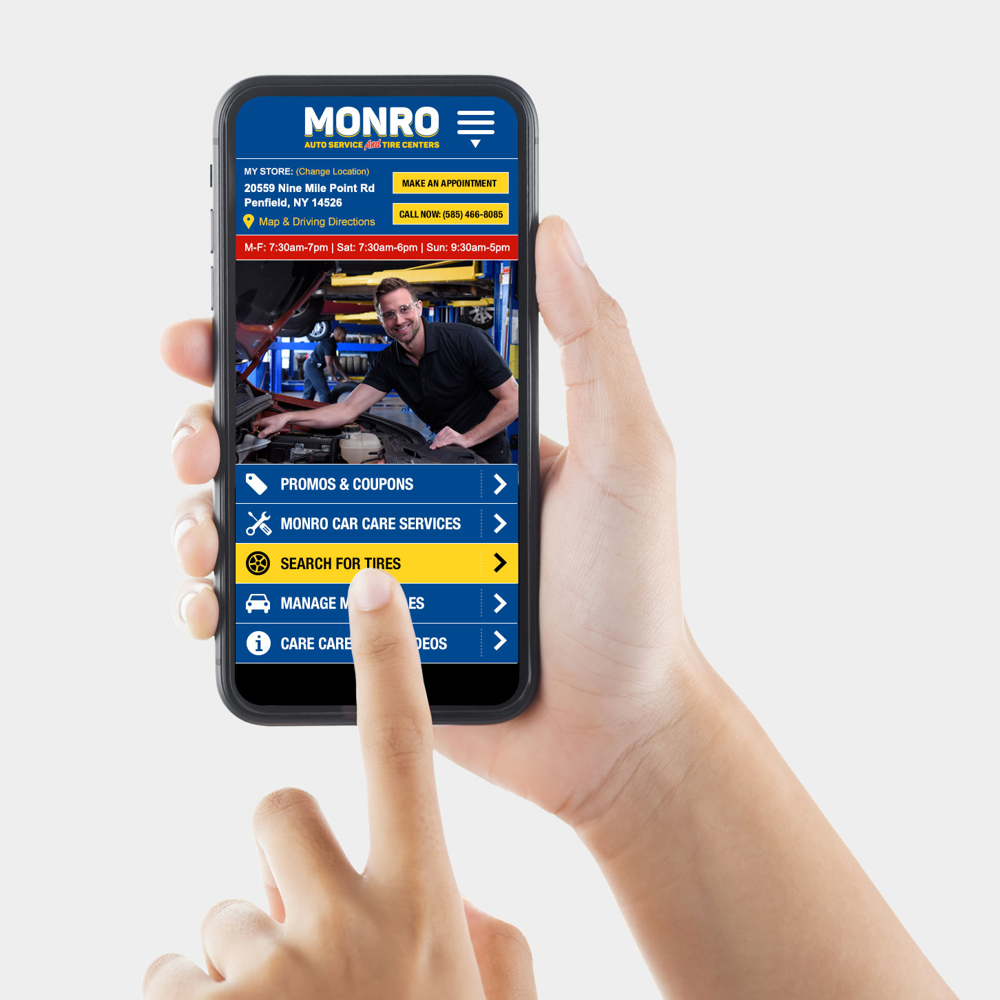 Photo of hands holding an iPhone with the Monro Auto Service mobile application displayed on screen.
