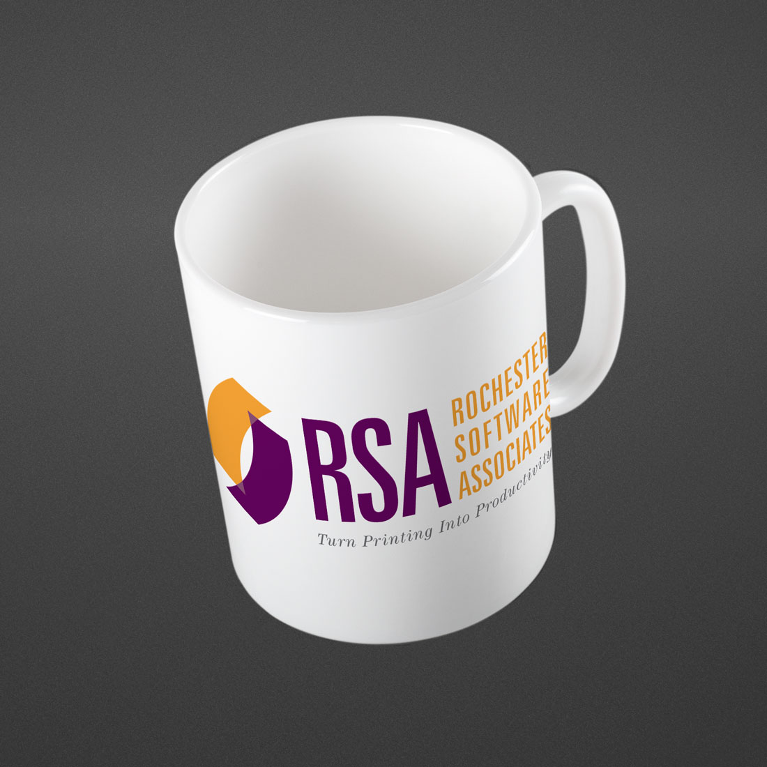 Photo of mug with Rochester Software Associates logo designed by Pixelpunk Creative.