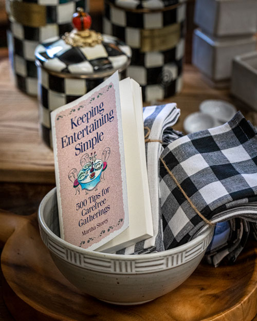 Photo of Social Media example for Windsor Cottage - Book in a bowl with napkins
