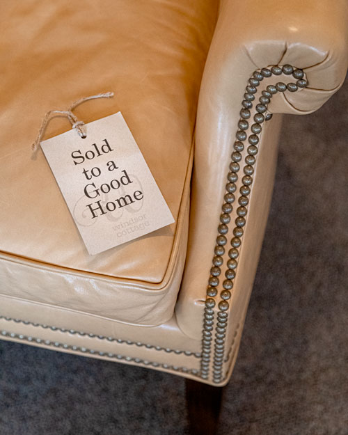 Photo of Social Media example for Windsor Cottage - Beige vintage chair with sold sign on seat.